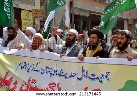 QUETTA, PAKISTAN - AUG 26:  Activists of Markazi Jamiat-e-Ehle Hadith are chanting  slogans in favor of democracy during a protest demonstration on August 26, 2014 Quetta.  - stock photo