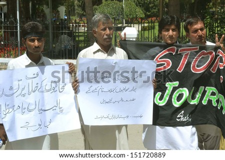 QUETTA, PAKISTAN - AUG 27: Members of Balochistan Union of Journalists are  demonstrating in favor of their demands during a protest press club on  August 27, 2013 in Quetta.   - stock photo