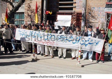 QUETTA, PAKISTAN - JAN 20: Supporters of Hazara Democratic Party (HDP) chant slogans in favor of their demands during a protest demonstration at Quetta press club on January 20, 2012 in Quetta, Pakistan. - stock photo