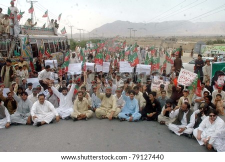 QUETTA, PAKISTAN - JUN 12: Supporters of Tehreek-e-Insaf (PTI) protest against US drone attacks during demonstration on June 12, 2011in Quetta.
