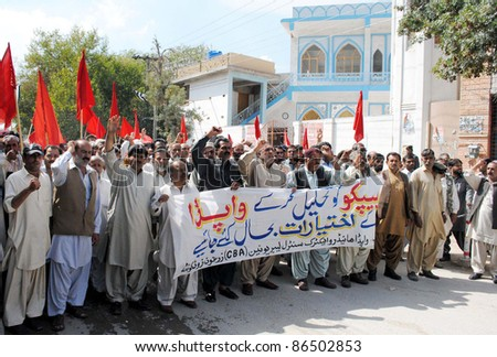 QUETTA, PAKISTAN - OCT 12: Supporters of WAPDA Hydro Electric Central Labor Union chant slogans in favor of their demands during protest demonstration on October 12, 2011in Quetta, Pakistan. - stock photo