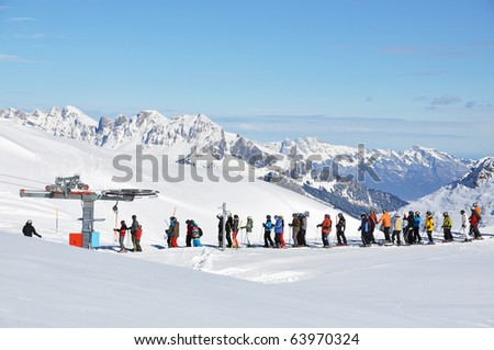 Queue at the ski lift - stock photo