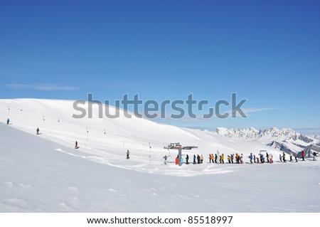 Queue at the ski lift - stock photo
