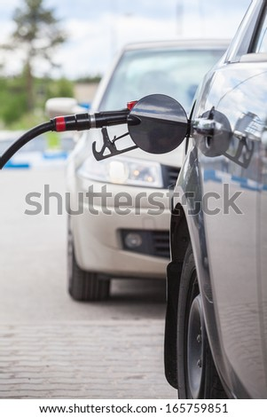 Queue of cars at a petrol station - stock photo