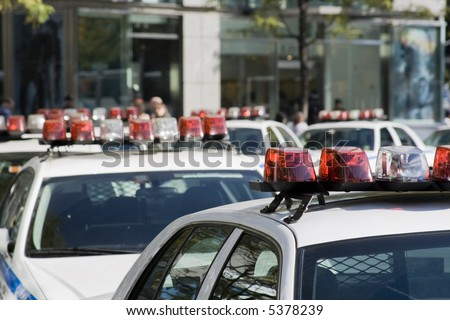 Queue of dozen police cars in New york streets. - stock photo
