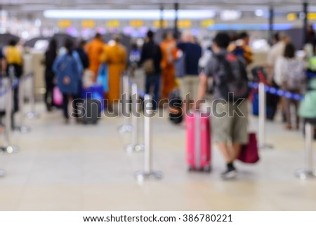 Queue of passengers check-in service at airport. - stock photo