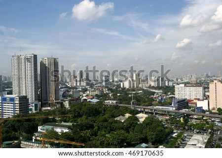 QUEZON CITY, PHILIPPINES - JULY 21, 2016: A bird's eye view of the commercial and residential buildings and structures in Quezon City, Philippines.