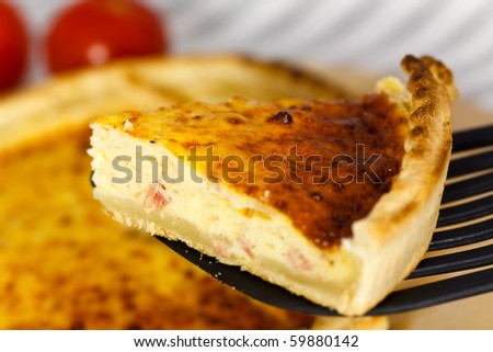 Quiche Lorraine on the cutting board - stock photo