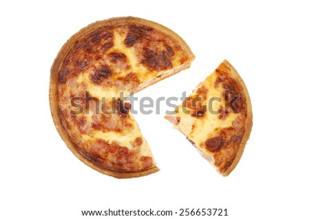 Quiche Lorraine with a slice cut out isolated against white - stock photo