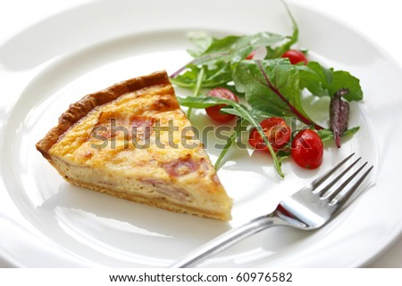 Quiche Lorraine with salad - stock photo
