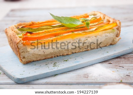 Quiche with cheese and vegetables - stock photo