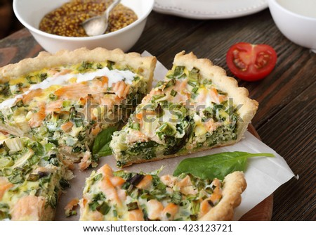 quiche with fish and spinach, food close-up - stock photo