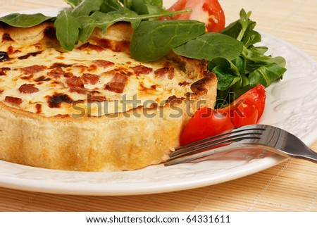 Quiche with Lettuce and tomato salad - stock photo