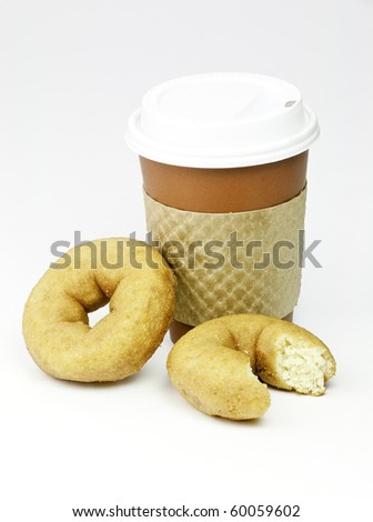 Quick breakfast of coffee and donuts - stock photo