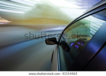 Quick turn on the car in city nightlife - stock photo