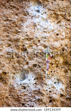 Quickdraw on the rock wall - stock photo