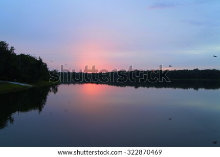 Quiet and still lake at dawn, beautiful sunrise on North Florida lake - stock photo