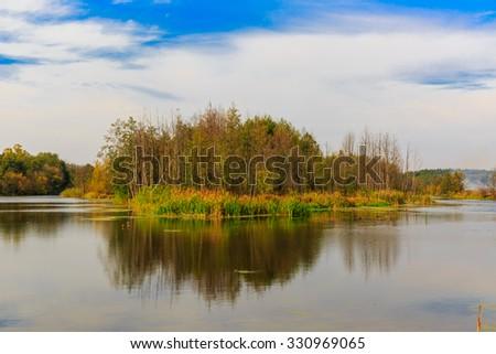 Quiet autumn landscape on lake - stock photo