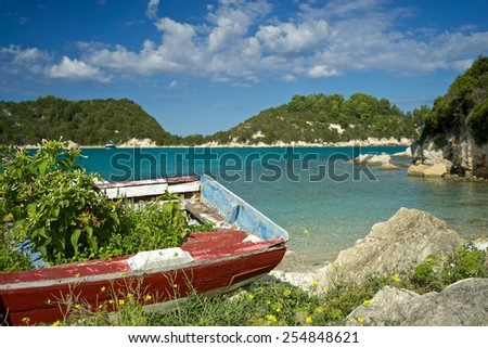 Quiet Bay with Beach and Old Boat on Paxos Island, Greece - stock photo