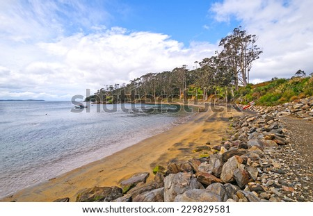 Quiet Cove on a Rustic Coastline near Halfmoon Bay on Stewart Island in New Zealand - stock photo