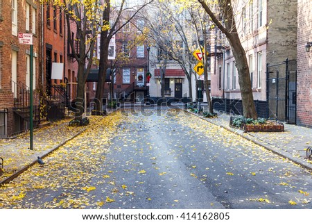 Quiet Empty Commerce Street in the Historic Greenwich Village Neighborhood of Manhattan, New York City - stock photo