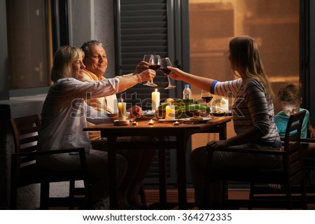 Quiet family dinner in the backyard - stock photo