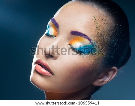 Quiet girl in the bright makeup - stock photo