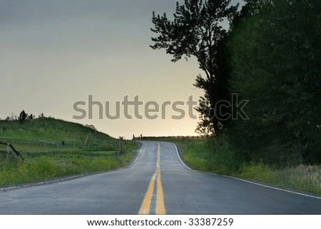 Quiet Highway after a storm at sunset. - stock photo