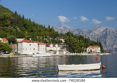 Quiet historic town of Perast with white houses, boats on the slopes of Mount St. Elias, Montenegro
