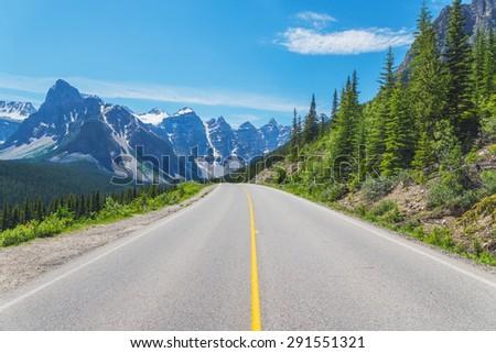 Quiet mountain road near Moraine Lake in Alberta, Canada - stock photo