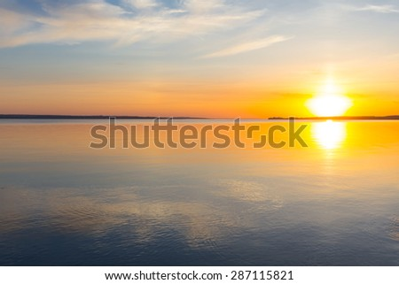 quiet river at the sunset - stock photo
