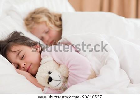 Quiet siblings sleeping in a bedroom - stock photo