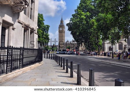 Quiet street in Westminster leading to the clock tower Big Ben. London, UK. - stock photo