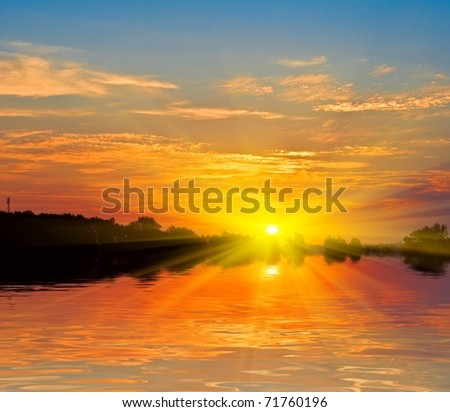 quiet sunset on a river - stock photo