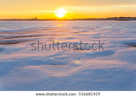 quiet sunset over a winter plains