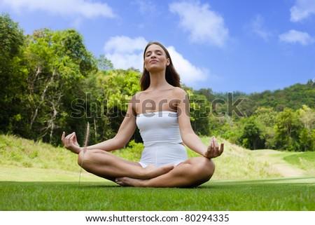 Quiet young woman practicing yoga's pranayama - stock photo