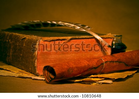 Quill, inkwell, book with an antique look