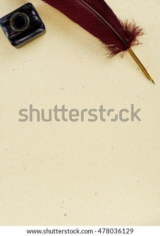 Quill, manuscript and ink well