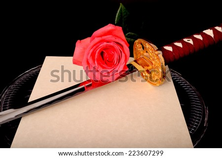 Quill parchment sword and rose isolated over black - stock photo