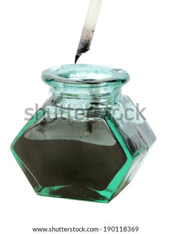 Quill pen and ink bottle - stock photo