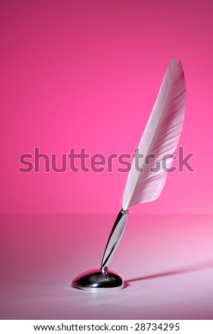 Quill pen isolated on purple background - stock photo
