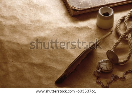 quill pen on vintage paper - stock photo