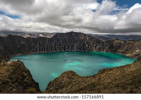 Quilotoa is a water-filled caldera that was formed by the collapse of the volcano following a catastrophic eruption about 800 years ago. Quilotoa is a tourist site of growing popularity.   - stock photo