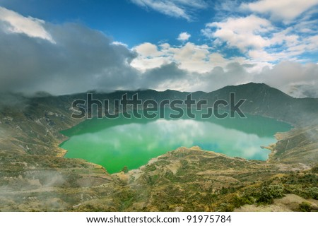 Quilotoa lagoon in Ecuador`s highlands of Andes formed on an ancient volcano crater. - stock photo