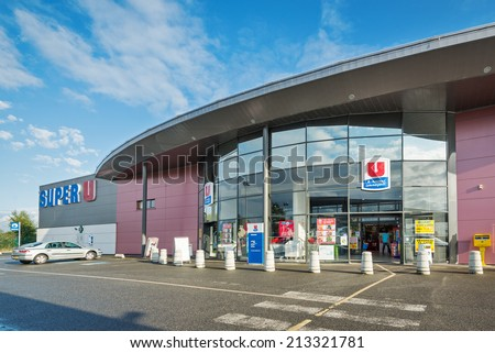 QUIMPER, FRANCE - AUGUST 6, 2014: Super U market. Systeme U is a French retailers' cooperative, comprising about eight hundred independent supermarkets, it is the 6th largest retail group in France. - stock photo