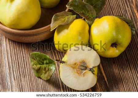 quince on vintage wooden background