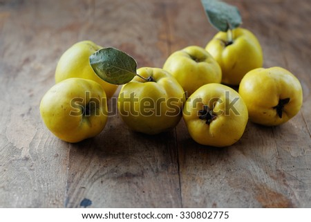 Quince on wooden table - stock photo