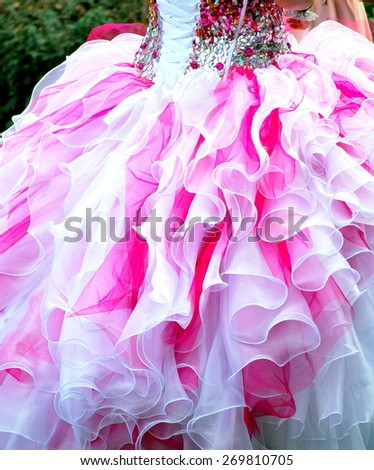 Quinceanera gown worn by female at her coming out ceremony. - stock photo