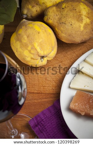 Quinces, quince sweet, cheese, walnuts and hazelnut - stock photo