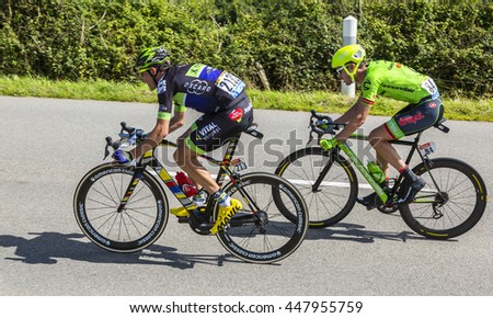 QUINEVILLE,FRANCE - JUL 2:Anthony Delaplace and Alex Howes riding in the breakaway during the first stage of Tour de France in Quineville, France on July 2, 2016.